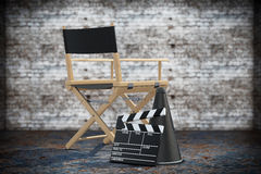 Director Chair, Movie Clapper and Megaphone. 3d Rendering. Director Chair, Movie Clapper and Megaphone on a grunge background. 3d Rendering Stock Photo