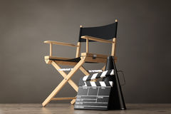 Director Chair, Movie Clapper and Megaphone. 3d Rendering. Director Chair, Movie Clapper and Megaphone on a wooden floor. 3d Rendering Royalty Free Stock Images