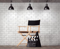 Director Chair, Movie Clapper and Megaphone in front of Brick Wa. Ll with Blank Frame extreme closeup stock photo