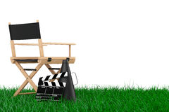 Director Chair, Movie Clapper and Megaphone over Grass. 3d Rende. Director Chair, Movie Clapper and Megaphone over Grass on a white background. 3d Rendering Royalty Free Stock Images