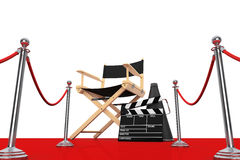 Director Chair, Movie Clapper and Megaphone over Red Carpet with. Barrier on a white background. 3d Rendering Royalty Free Stock Photo