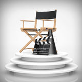 Director Chair, Movie Clapper and Megaphone over Round Stage. 3d. Director Chair, Movie Clapper and Megaphone over Round Stage on a white background. 3d Royalty Free Stock Images
