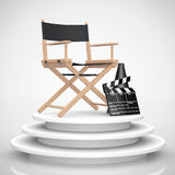 Director Chair, Movie Clapper and Megaphone over Round Stage. 3d. Director Chair, Movie Clapper and Megaphone over Round Stage on a white background. 3d Stock Photo