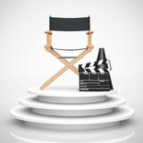 Director Chair, Movie Clapper and Megaphone over Round Stage. 3d. Director Chair, Movie Clapper and Megaphone over Round Stage on a white background. 3d Stock Photography