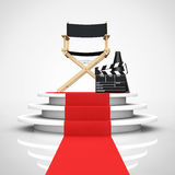 Director Chair, Movie Clapper and Megaphone over Round White Ped. Estal with Steps and a Red Carpet on a white background. 3d Rendering Stock Image