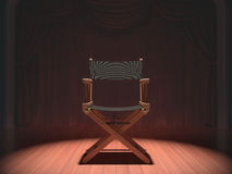 Director Chair. Director's chair on the stage illuminated by floodlights Stock Image