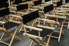 Director chair, stools in the waiting room. With empty chairs Stock Photography