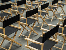 Director chair, stools in the waiting room. With empty chairs Royalty Free Stock Photo