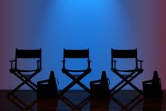 Director Chairs, Movie Clappers and Megaphones with Blue Backlig Royalty Free Stock Photography