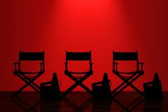 Director Chairs, Movie Clappers and Megaphones with Red Backligh Stock Photo