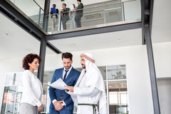 Director of company have meeting with middle East partner. Female director of company and her manager have meeting with middle East partner royalty free stock image