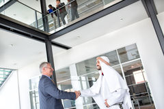 Director of company receive Arabian businessman. Director of global company receive Arabian businessman stock image