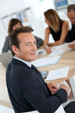 Director empresarial en la reunión Imagen de archivo libre de regalías