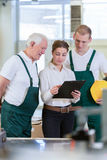 Director and her workers Royalty Free Stock Photo