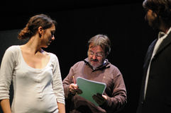 A director instructs an actress. Both from the Barcelona Theater Institute. BARCELONA - JAN 13: A director instructs an actress. Both from the Barcelona Theater Royalty Free Stock Photo