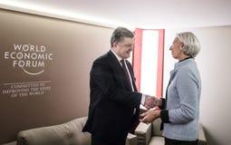 Director of International Monetary Fund Christine Lagarde and Pe. DAVOS, SWITZERLAND - Jan 19, 2017: President of Ukraine Petro Poroshenko and the director of royalty free stock photography