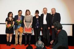 Director Kazim Öz 2.f.l. get a price at the Internationales Filmfestival Mannheim-Heidelberg 2017. Mannheim/Heidelberg, Deutschland, 2017-11-18. Der Preis Royalty Free Stock Image