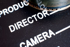 Director label on movie clapper board and film reel Royalty Free Stock Images