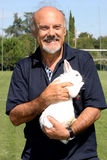 The director Luciano Capponi with a rabbit in her arms Royalty Free Stock Photos