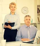Director`s assistant makes daily routine. Mature director`s assistant makes daily routine and planning meeting at office royalty free stock photography