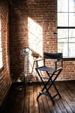 Director`s chair. reflector lamp light from window, solar stock photo