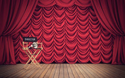 Director`s chair on stage with red curtains. 3D rendering. Director`s chair on stage with red curtains background. 3D rendering Royalty Free Stock Photo