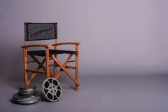 Film director's chair with movie reel Stock Photos