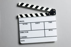 Director's slate board. A director's slate board in grey background Royalty Free Stock Photography