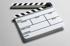 Director's slate board. A director's slate board in grey background royalty free stock photos