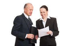 Director and secretary looking at documentation. Isolated on white background royalty free stock photos
