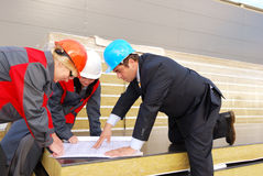 Director with subordinates on construction site Stock Photos