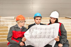 Director with subordinates on construction site. Director and engineers on construction site of shopping center Stock Images