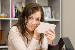 Director tints eyes in the workplace Royalty Free Stock Photography