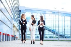 The director and two assistants discuss plans. Concept for business, boss, robot, team and success.  stock image