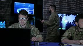 Director in uniform in monitoring room on war base, people stock footage