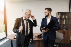 The director was playing golf in the office. The subordinate came to him with a report Royalty Free Stock Photography