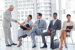 Director welcoming a businesswoman Royalty Free Stock Image