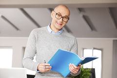 Director working on business report Stock Photos
