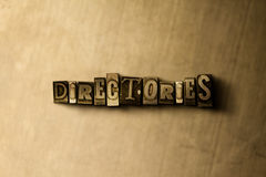 DIRECTORIES - close-up of grungy vintage typeset word on metal backdrop Royalty Free Stock Photo