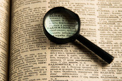 Directory. Dictionary. Magnifying glass on the word 'appropriate Stock Images