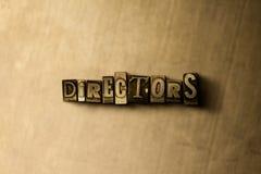 DIREKTOREN - Nahaufnahme des grungy Weinlese gesetzten Wortes auf Metallhintergrund lizenzfreie stockfotografie