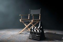 Direttore Chair, valvola di film e megafono nel Li volumetrico Fotografia Stock Libera da Diritti