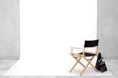 Direttore Chair, valvola di film e megafono nello studio Roo del cinema Immagini Stock Libere da Diritti