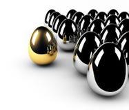 Direzione dorata di concetto dell'uovo Fotografia Stock Libera da Diritti