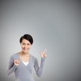 Dirigeant le doigt vers le haut photographie stock libre de droits