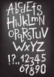 Dirigez l'ABC de latin, les nombres et les signes de ponctuation tirés par la main illustration libre de droits