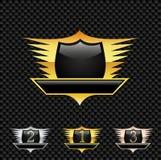 Dirigez l'emblème/médailles - sur le fond de carbone Photo stock
