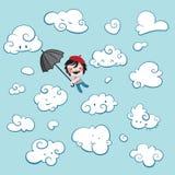 Vol mignon de garçon parmi des nuages Photo libre de droits