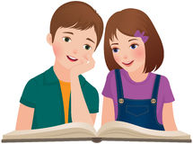 Les enfants ont lu le livre Photo stock