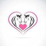Dirigez l'image de deux chevaux sur une forme de coeur Images libres de droits